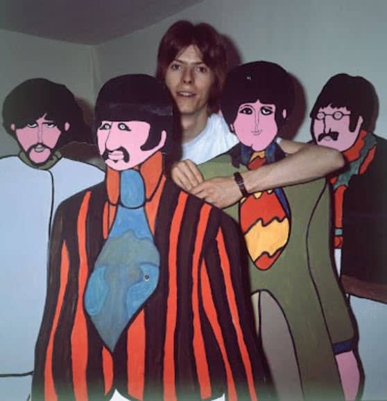 David Bowie with cutouts of The Beatles from Yellow Submarine