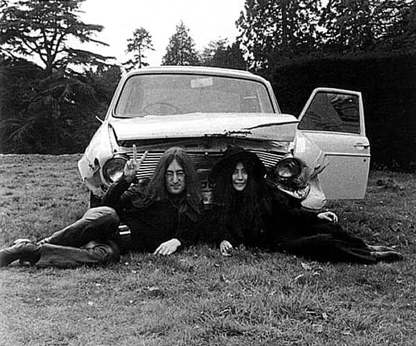 John Lennon and Yoko Ono with their crashed Austin Maxi, Tittenhurst Park, 1969