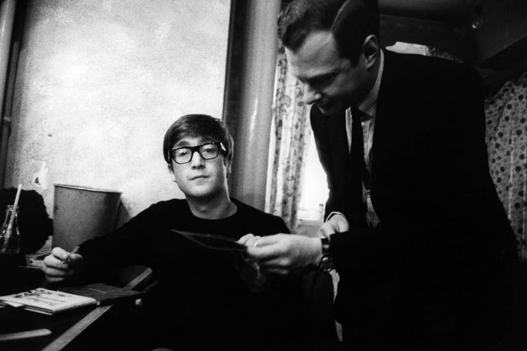 John Lennon and Brian Epstein, 1963