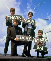 The Beatles holding 'Thank Your Lucky Stars' signs on 18 August 1963
