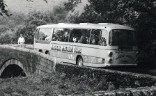 The Beatles' Magical Mystery Tour coach gets stuck on a br