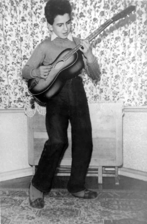 George Harrison Playing The Guitar Circa 1950