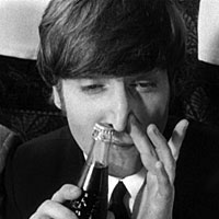 John Lennon sniffs a Pepsi bottle in A Hard Day's Night, 1964