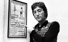 John Lennon with the Mr Kite poster, 1967