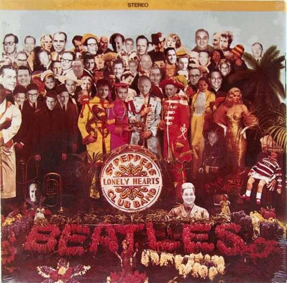 Sgt Pepper's Lonely Hearts Club Band featuring faces of Capitol Records staff members