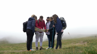 videoblocks-lost-group-of-teenage-friends-checking-the-map-trying-to-find-out-the-right-way-on-foggy-mountain-top_blif4ezof_thumbnail-full01.png