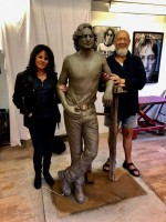 Laura-Lian-and-Michael-Eavis-with-JLP-statue.jpg