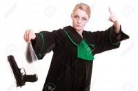 32316749-law-court-or-justice-concept-emotional-woman-polish-lawyer-attorney-holding-weapon-gun-bag-marked-ev.jpg